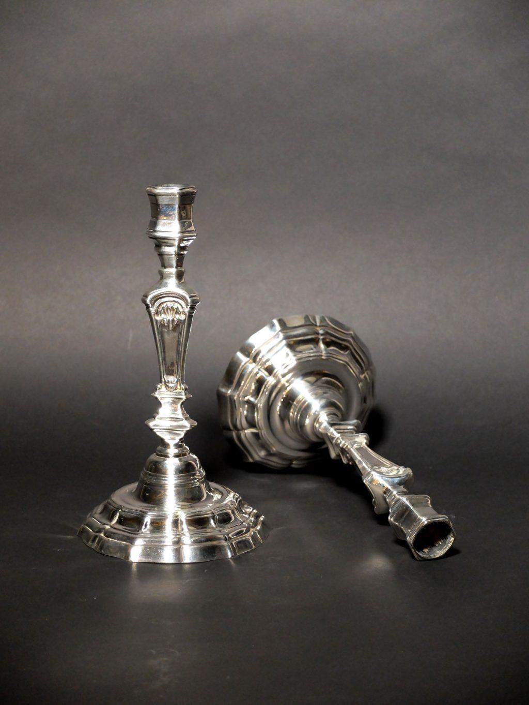 Paire de bougeoirs XVIIIème en métal argenté